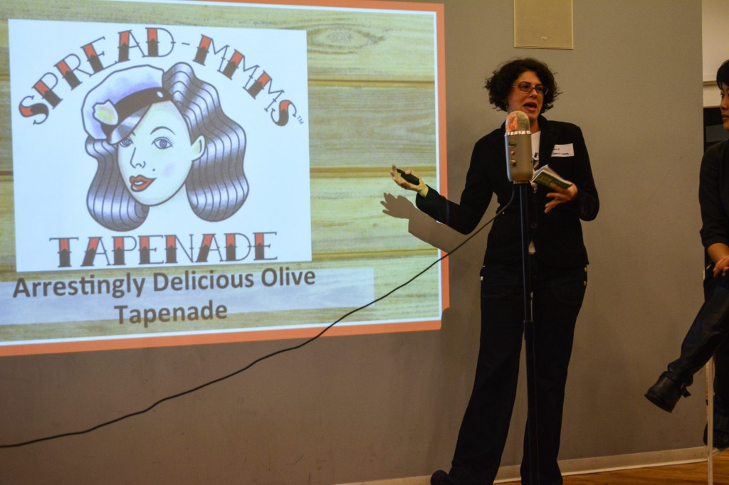 Who thought olive tapenade could be so fun? Spread-mmms gets a laugh from the crowd.